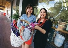 Daisy and Rowe owner Julie Fazey with customer Rebecca Stuchbery receiving donations for the less fortunate.