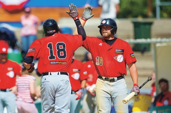 Perth Heat's Brian Pointer, right, congratulates Nick Rulli on a home run.