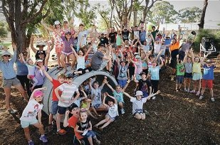 Sixty thousand reasons to celebrate: the team that built the nature playground for $1000 instead of the estimated $60,000.