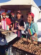 Nurul Haq Association of WA members cooking at one of the stalls (left) and Zap Circus performers entertain the crowd.