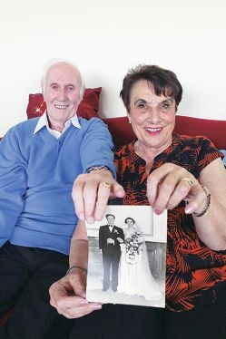 Alex and Maureen Chisholm with a photo from their wedding day. Picture: Emma Goodwin www.communitypix.com.au d426990