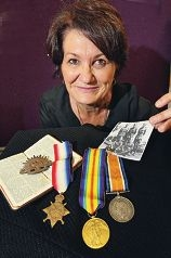 Penny Reynolds with her great grandfather's war medals and Bible