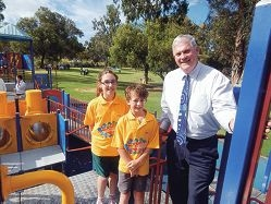 Children's Reference Group members Loreto Grace and Charlie Dangar with Cockburn Mayor Logan Howlett near the site where the new playground will be built.