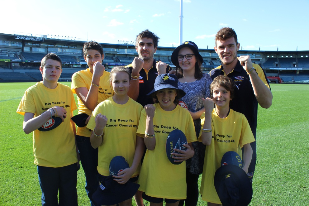 William Stagg (second from left) and Caelan Mack (front right) with other mascots and Eagles players Andrew Gaff and Luke Shuey.