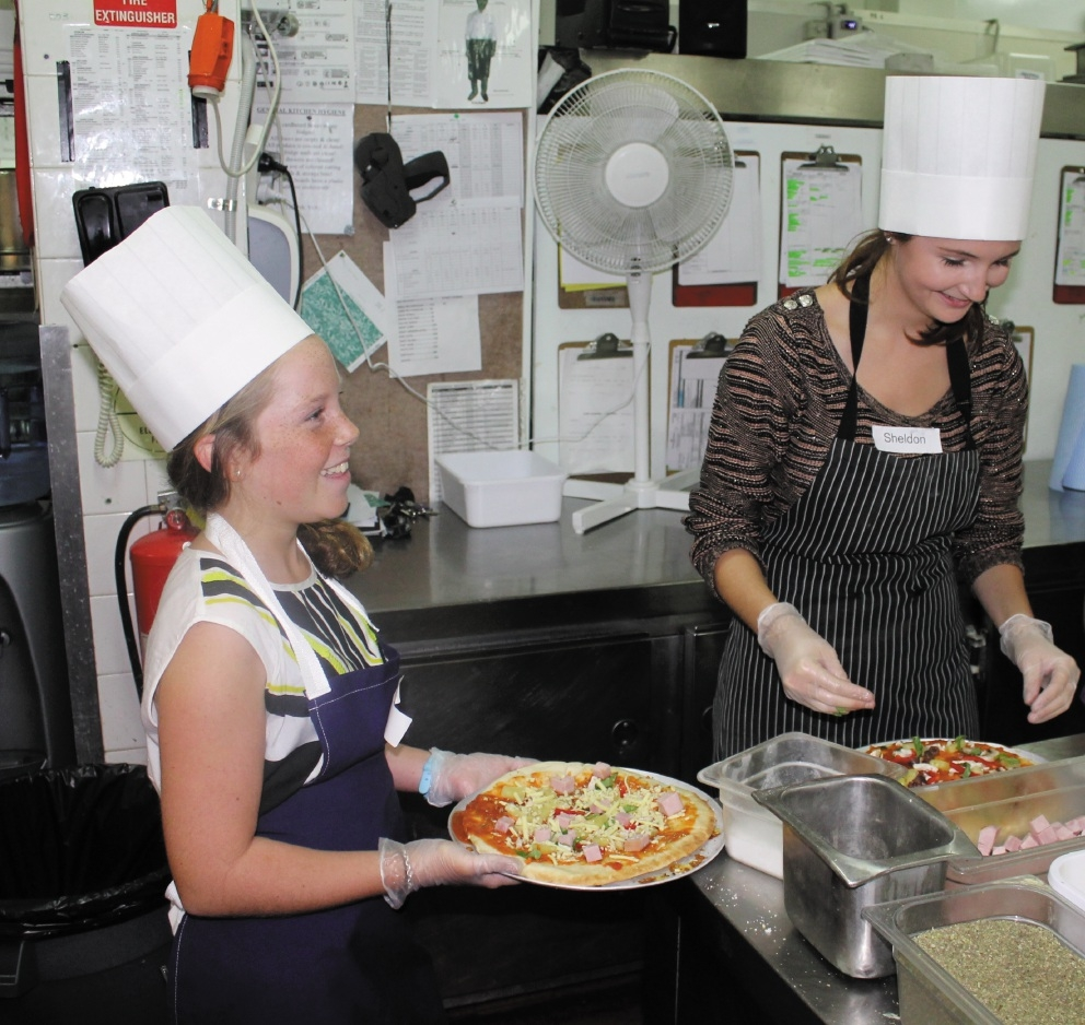 Emma O'Donoghue (14) and her mentor Sheldon Hayes (25), matched in the YMentoring service, took part in a  Pizza and Cupcake Night at Parmelia Hilton Perth.