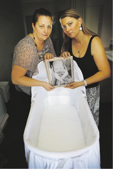 Kristy Wiegele and Shannon Cook with  a photo of