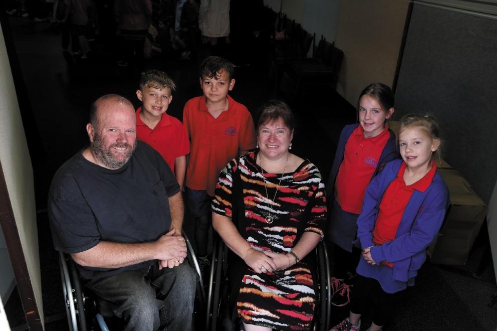 Martin and Kerrie Duff (front) with Quinns Rocks Year 4 students Taj Bennett, Brayden Seddon, Grace Rea, Mykala Hill.