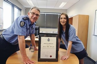Superintendent Allan Adams with Jemma McConnell and her award. Picture: Emma Goodwin d428498