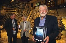 The MAAWA's Ian Warne holding an iPad showing the new app with Ian Macleod, executive director of Fremantle Maritime Museums (centre) and curator Ross Anderson.