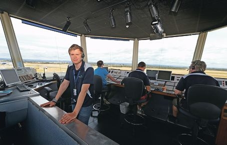 Air traffic controller Joshua Minchenko at work in the Jandakot Airport tower. Picture: Martin Kennealey d429473