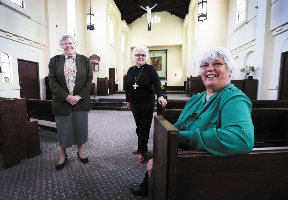 Parishioners Maurine Callard and  Margaret Bennett  with  the reverend Dr Georgina Hawley. Picture: Matt Jelonek           d439173