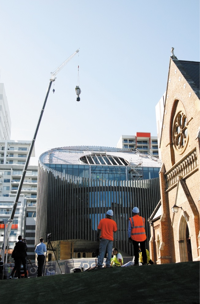 A weeping fig being craned into the new library.