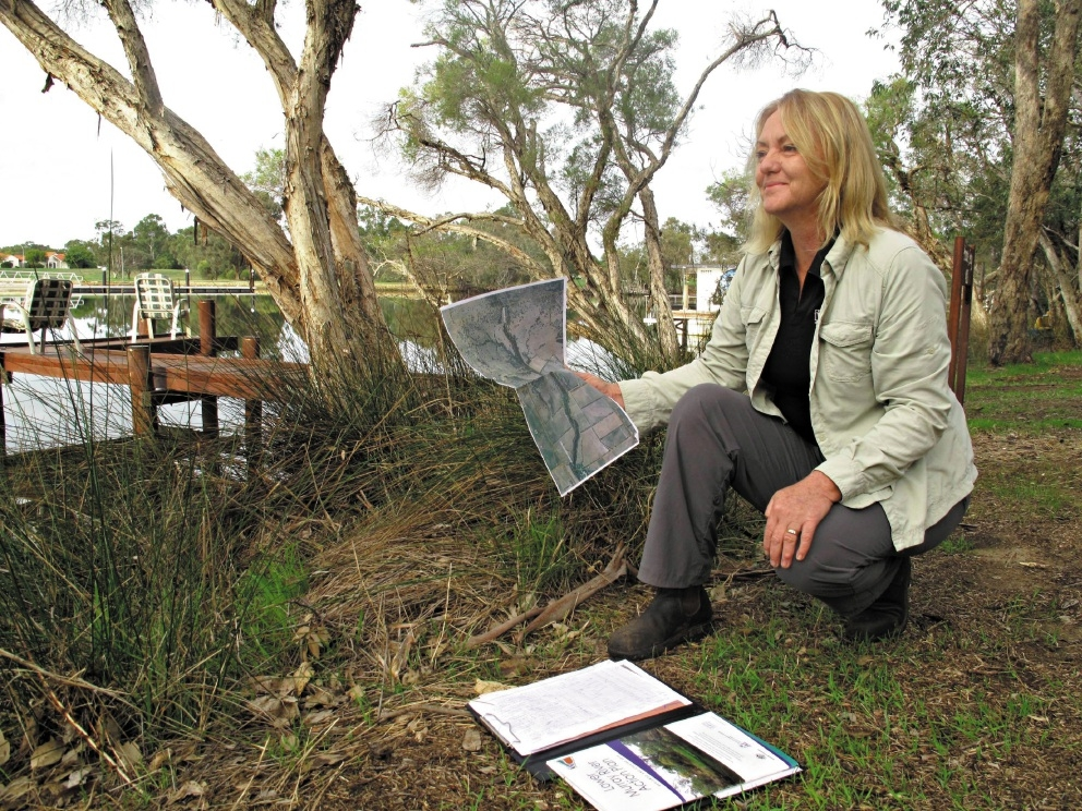 Peel-Harvey Catchment Council project officer Jo Garvey with the river action plan that |establishes priorities for the Murray River mid-reaches.