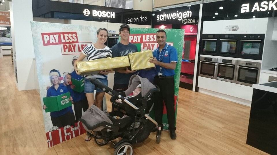 Sarah and Tim Medwell with Good Guys Midland store manager Dinesh Mepani, and |Lachlan and Ollie.