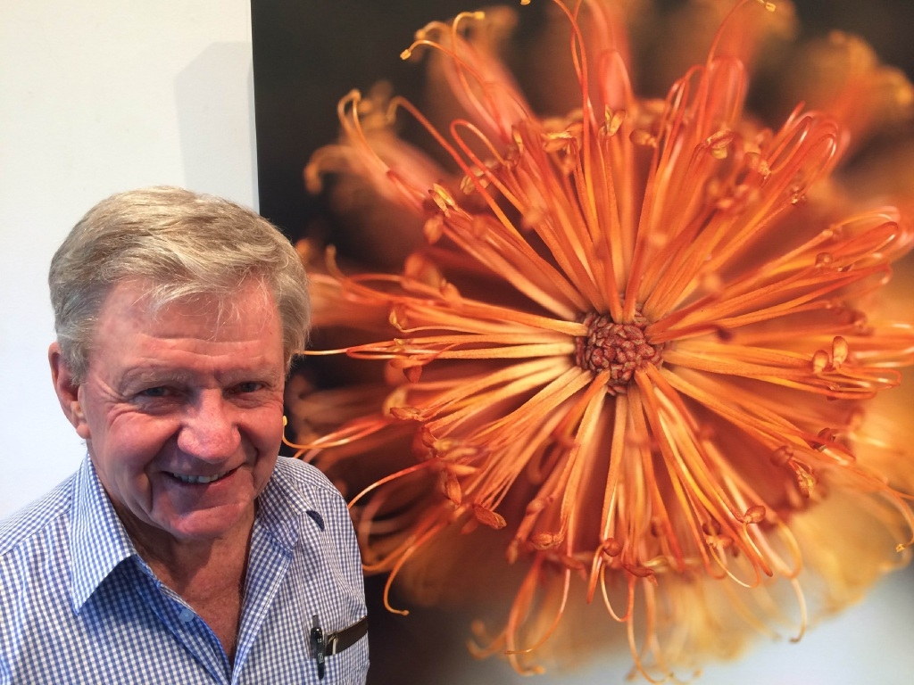 John E Maloney with one of his banksia photographs.
