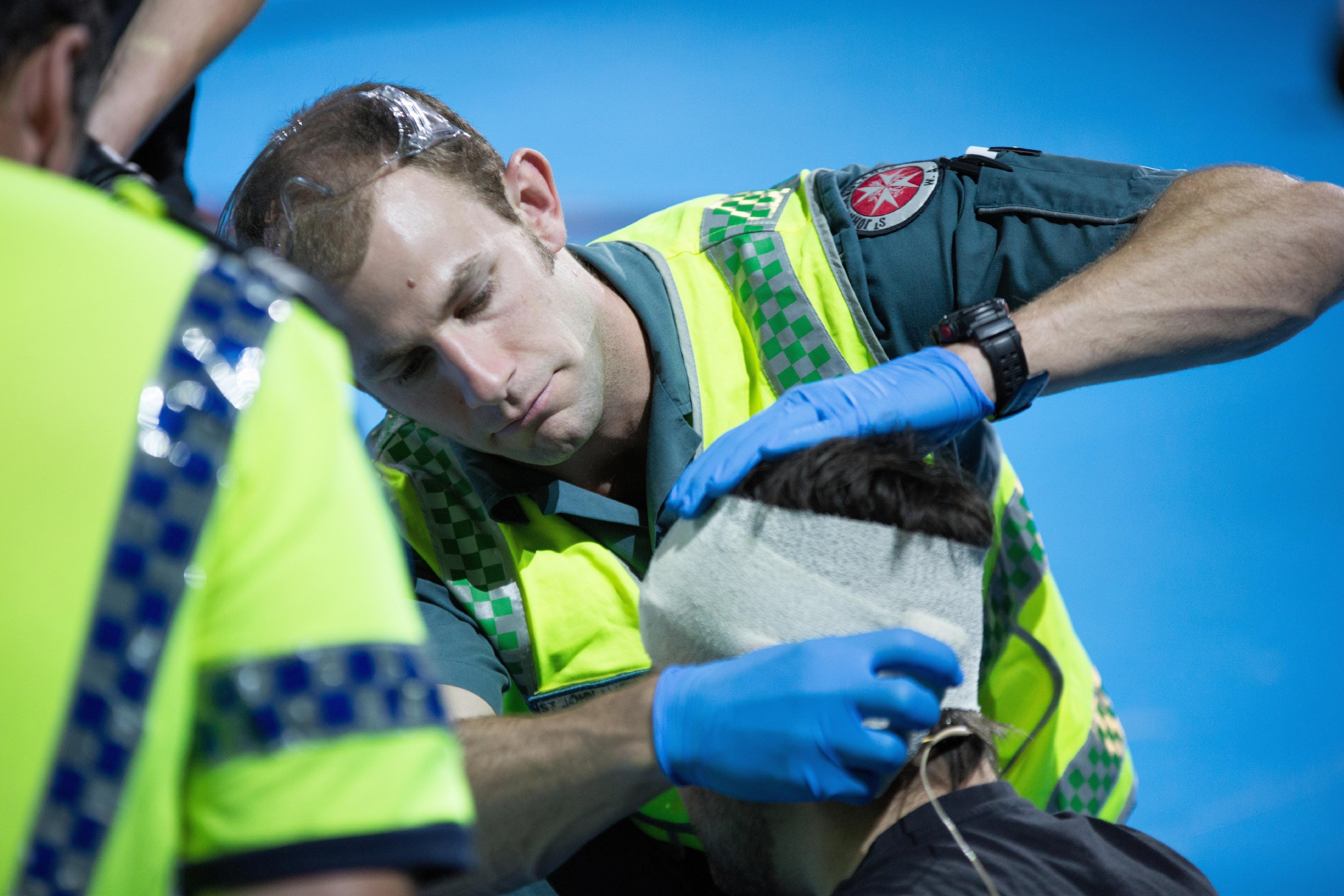 St John Ambulance WA paramedic Sandy Bent attends a 'patient' during a road crash re-enactment at the RAC's bstreetsmart event at Perth Arena. Picture: Glen Knight.