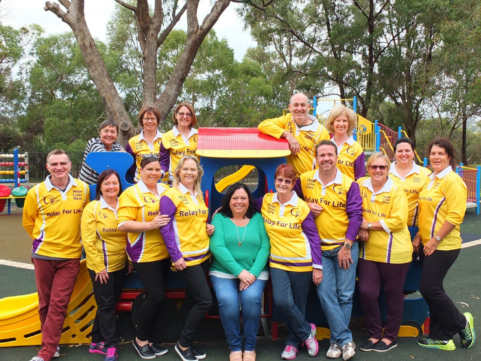 Cancer Survivor Amanda Chila is surrounded by other Relay for Life organising committee members at Neil Hawkins Park, Joondalup.