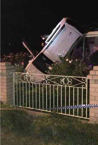 Munster: car flips and hits home after police chase