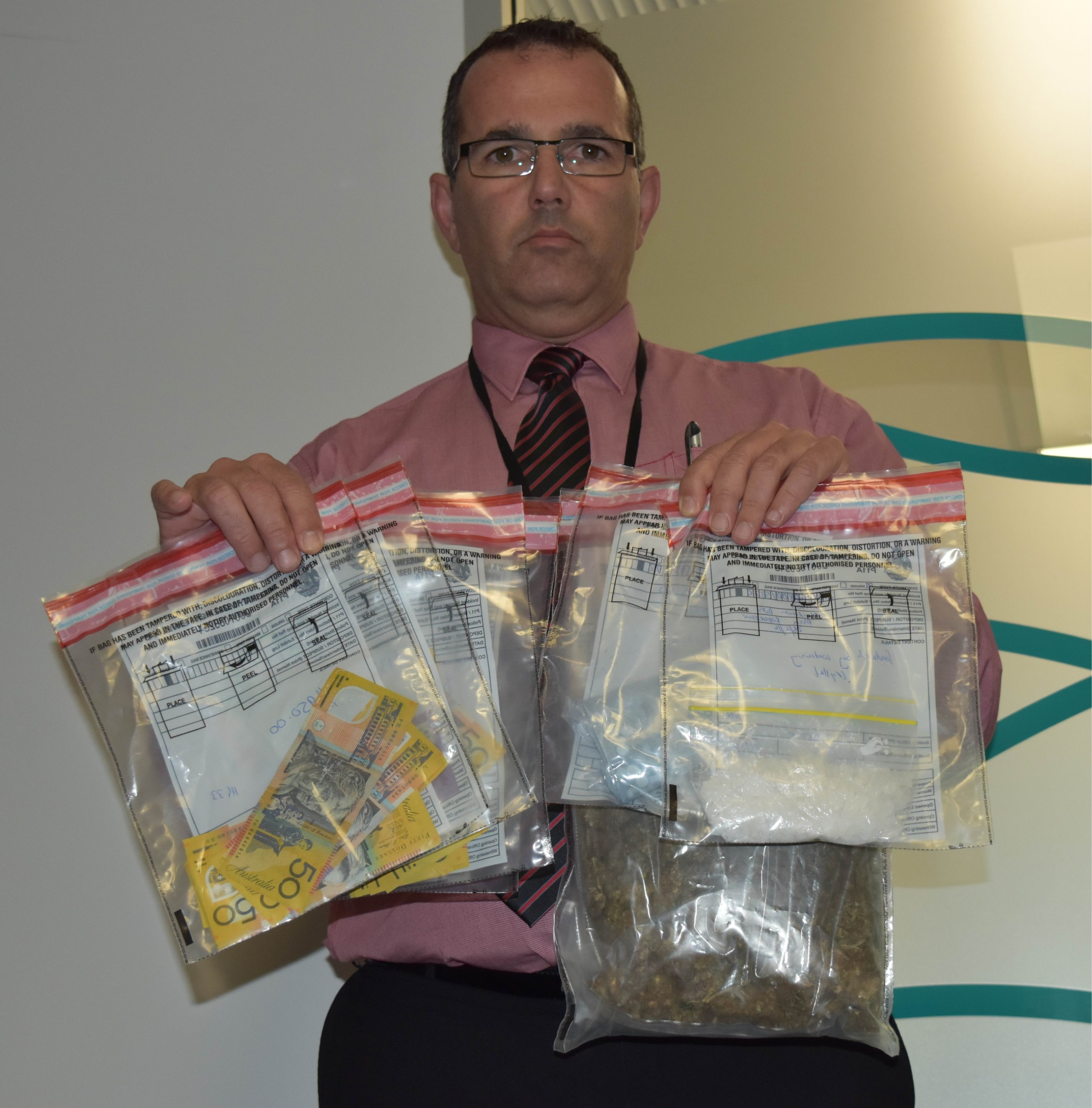Detective Sergeant Carlos Correia with some of the haul