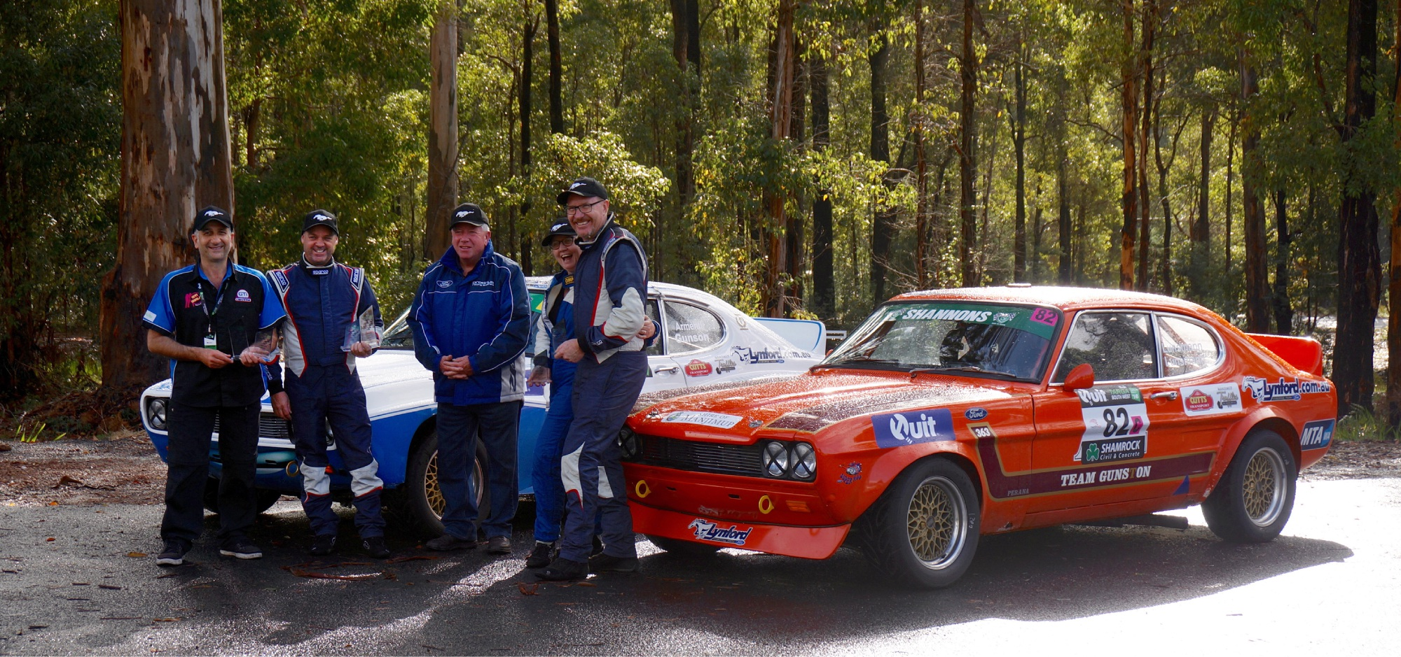 Front row: Murray Armenti (co-driver) and Simon Gunson (driver), Richard Cox, and Helen and Jurgen Lunsmann who competed in the A2.