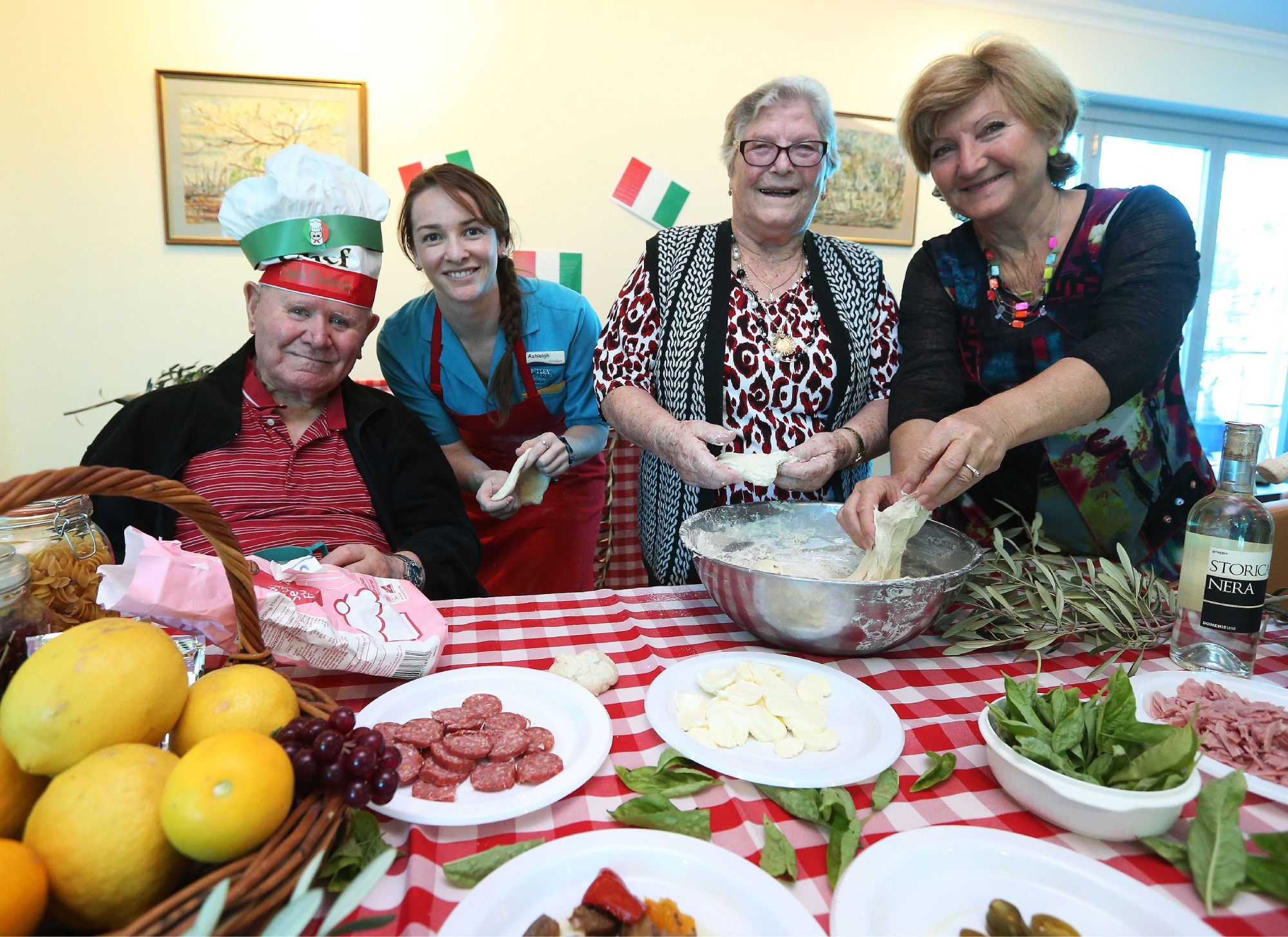 National Italian Day celebrations at Swan Care Kingia, Bentley. Resident Antonio Monaldi with activities officer Ashleigh Fitzgerald,  resident Cesira Puserla and daughter Lina Papagno.