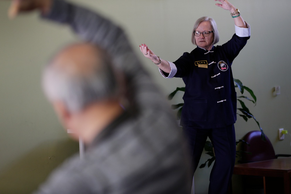 Monika Wong (WA Chief Instructor Australian Academy of Tai Chi) instructs a Stay On Your Feet class on how tai chi can help with arthritis. Picture: Andrew Ritchie d454856