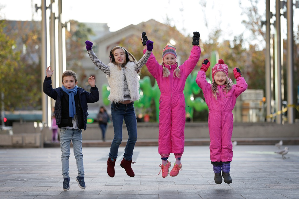 Ben Hickey (4), Ella Hickey (9), Harper Cassidy Blythe-Williams (8) and Lula Mae Blythe-Williams (5) in snow gear getting ready for the school holiday snow slide in Forrest Place. Picture: Andrew Ritchie