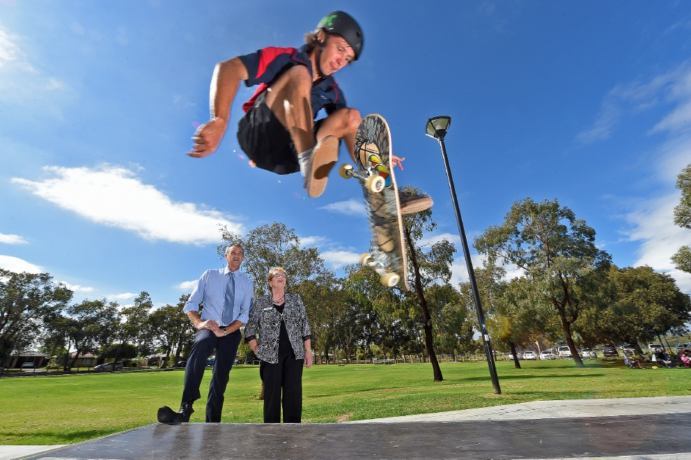 Tony Simpson and Gosnells Mayor Olwen Searle watch Gosnells youth worker Tom Bentley busting a huge 360 flip. Picture: Jon Hewson d452548