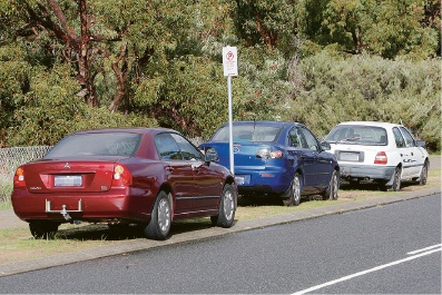 Illegally parked cars on a verge. Picture: Bruce Hunt