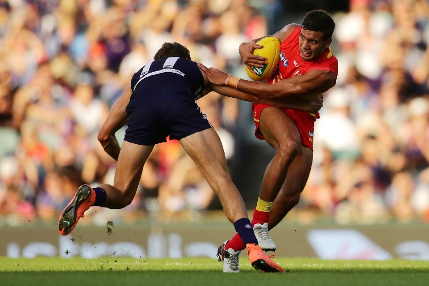 Dockers backman Tom Sheridan attempts to tackle Gold Coast Sun Callum Ah Chee last Saturday. Picture: Getty Images (Will Russell: AFL Media)