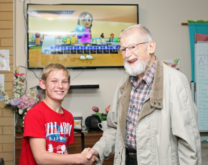 Year 7 student William Lethlean with 90-year-old William Snashall after a game of 10 pin bowling on the Wii console.