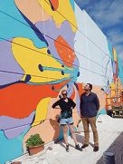 Artist Anya Brock with Slavin Architects' Bill Coe in front of Brock's as yet unfinished mural.