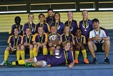 Captain Alex Robinson with the perpetual trophy (second row), coach Ryan Coutts (right) and the junior girls team.