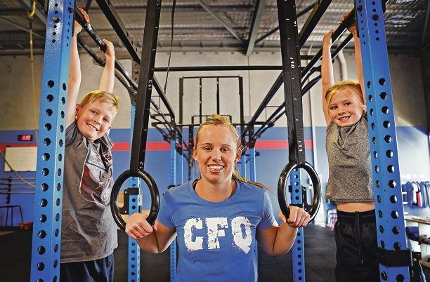 Fitness coach Rebecca Halliday with Aidan and Amelia Spencer. Picture: Elle Borgward www.communitypix.com.au d427880