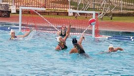 Melville Marlins goal keeper Manon Gebeon prepares to block a shot by North Coast Phoenix's Sofia Chaves.