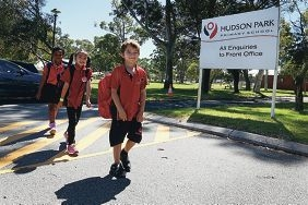 Year 2 students Gift Said and Thao Bui walk to school with Year 1 pupil Bayden Thaivichit.