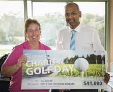 Cr Dot Newton and YouthCARE CEO Stanley Jeyaraj with the cheque for $41,000 raised through charity golf.