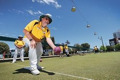Vision-impaired bowling champion Graham McLean in action.