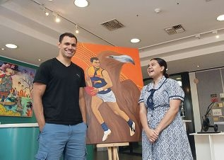 Eagles football player Josh Hill with his artistic cousin Marika Ugle.