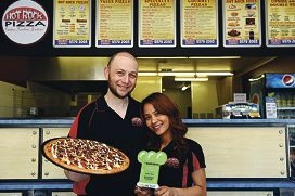 Hot Rock Pizza proprietors Met and Pla Erok with their award and delicious Mediterranean lamb pizza.d428201