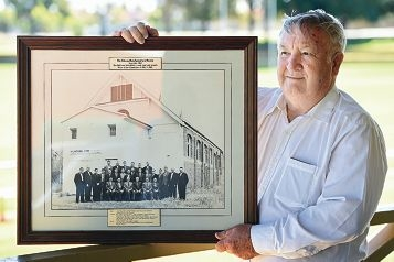 Graham Pittaway with the framed picture of the Osborne Park Agricultural Society hall and committee members in 1962. Picture: Marcus Whisson www.communitypix.com.au d428051