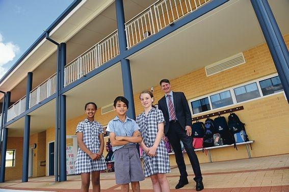 St Gerard's Catholic Primary School principal Mark Miloro outside the new block with students Hermela