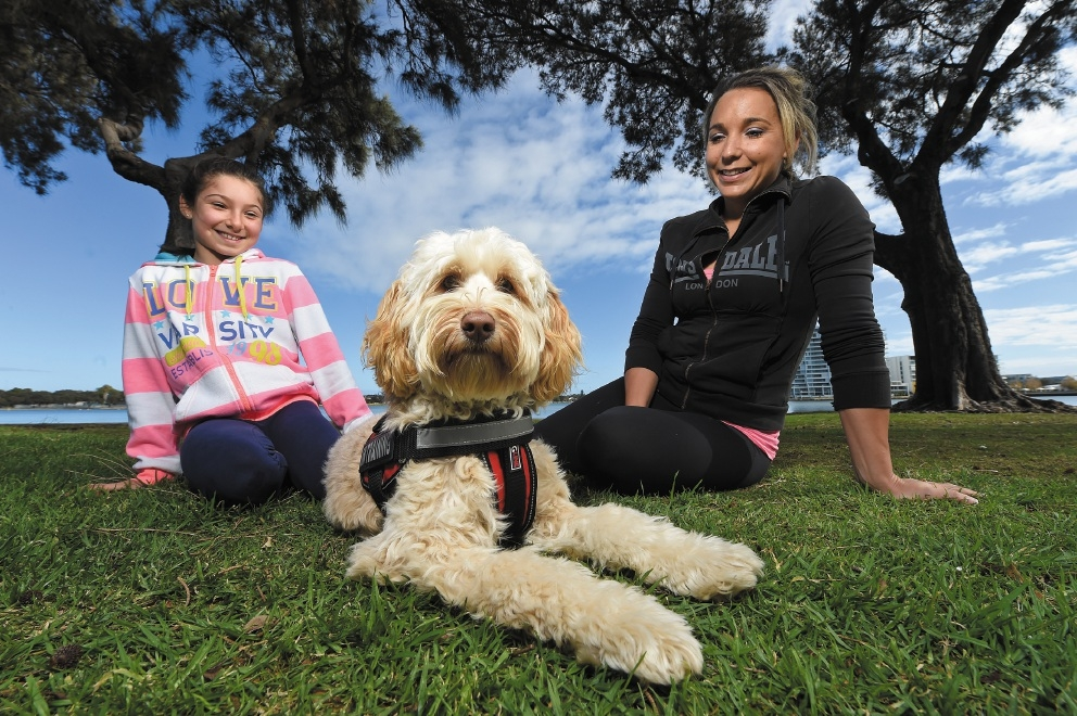 Lilly with Rosie the labradoodle working dog and Zoé Zarganis.