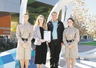 Sophie Collins accepts her award from Richard Olive, with Bush Ranger cadets Dane Botica and Ellesia Lothian.