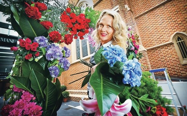 Florist Rebecca Grace has created two giant floral archways in the Wesley Quarter. Picture: David Baylis d428870
