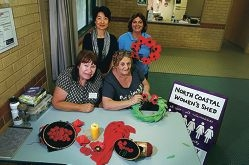 North Coastal Women's Shed members Moira Young, Ja-On Park, Pat Mosley and Gerry Sheldon make Remembrance Day poppies.|Picture: Emma Goodwin www.communitypix.com.au d428711
