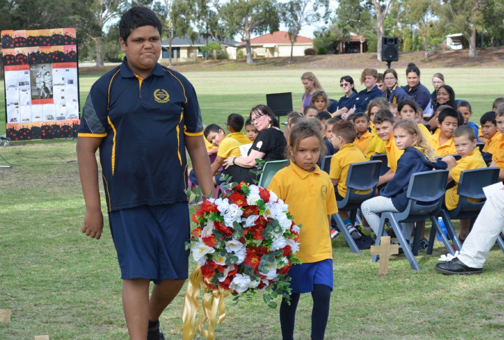 Embleton students lay a wreath.