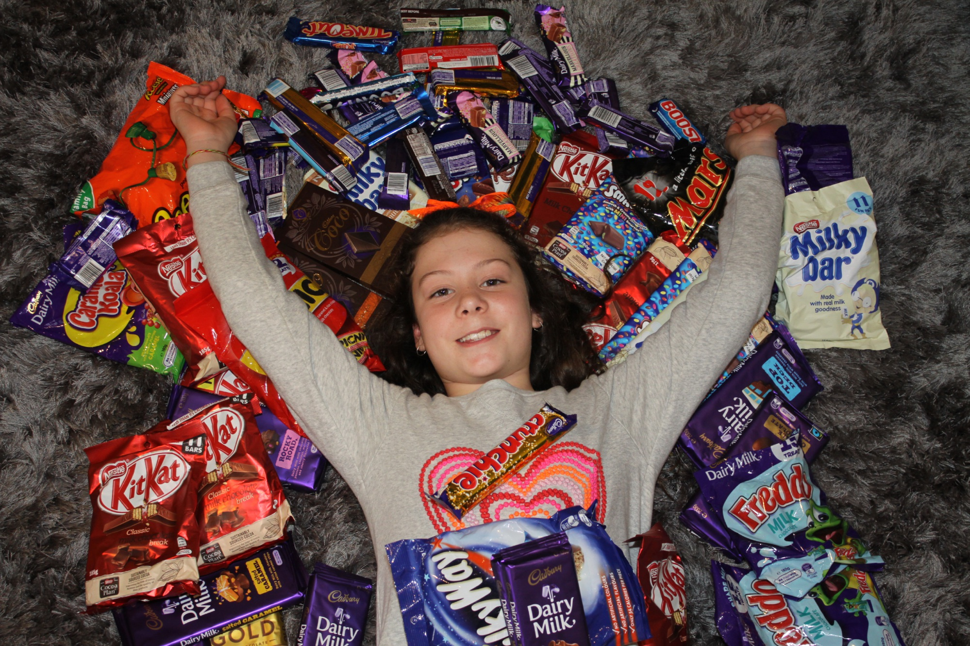 Waikiki girl Claudia Shirra (9) collects chocolates for SOUL Soup Patrol