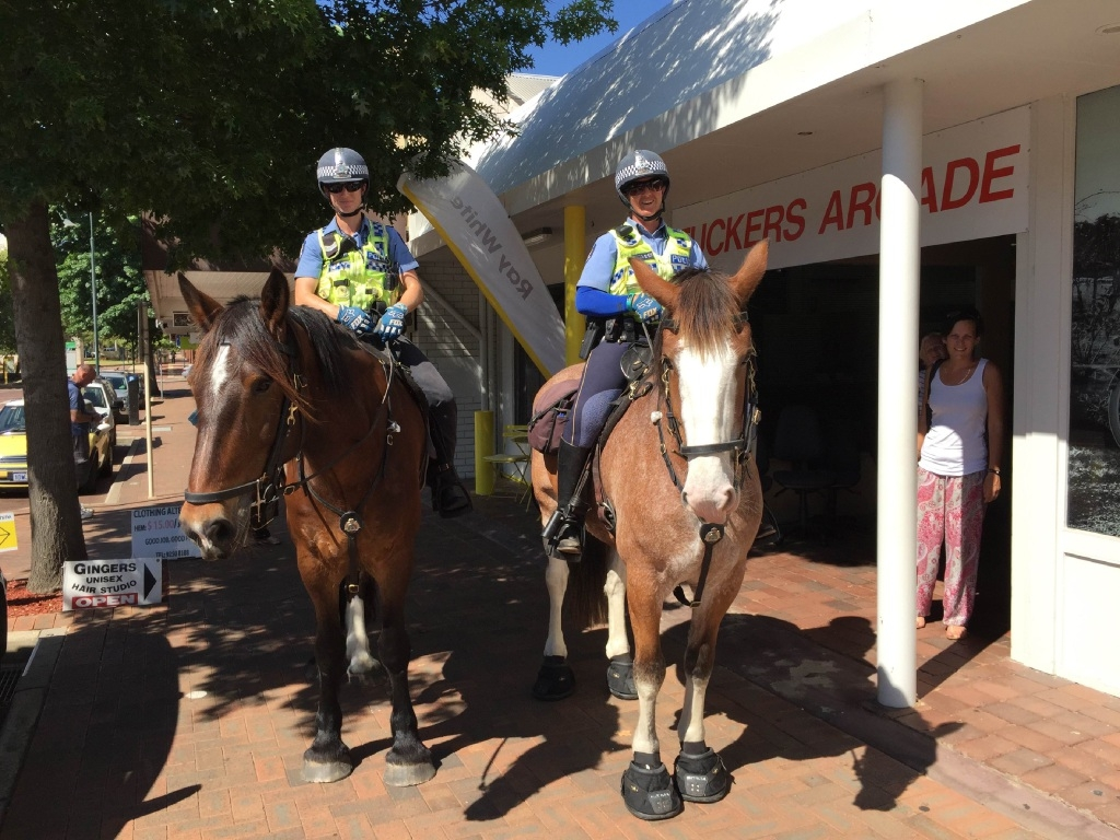 Constables Tenille Rossi (left) on Ralph and Sarah Price with Matilda.