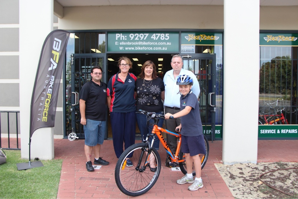 Ed Sault, Barb Goodnough, Anthea Marshall, Bike Force owner Mark Bailey and Noah Goodnough with his new bike.         Picture: Georgia Taylor